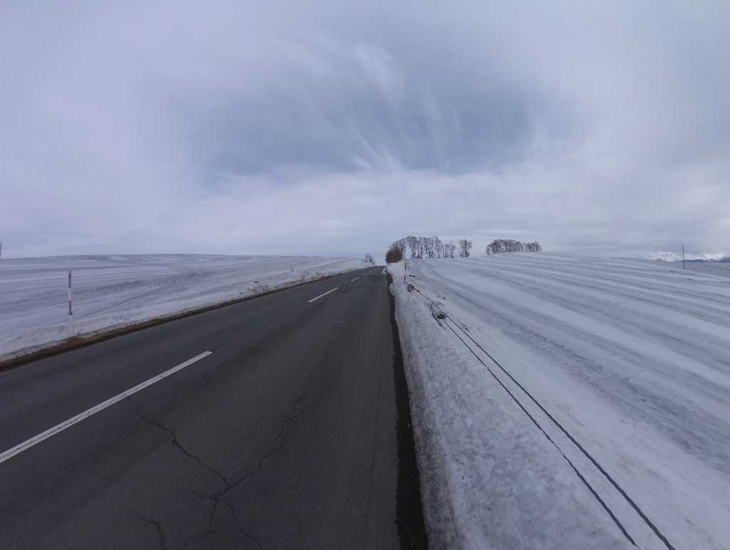 Road to Biei with wide snowfield
